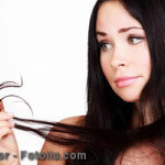 woman is not happy with her fragile hair, white background