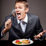 MAn burning his mouth on hot food